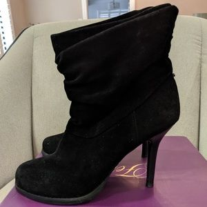 Black ankle boots by Fergie